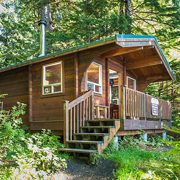 Located on the mainland on the shore of its namesake lake approximately 33 air miles northeast of Ketchikan