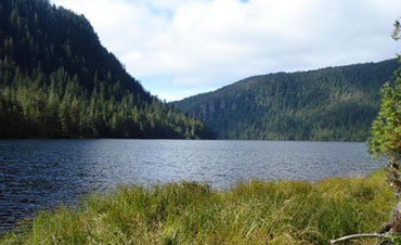 Shore of its namesake lake approximately 33 air miles northeast of Ketchikan