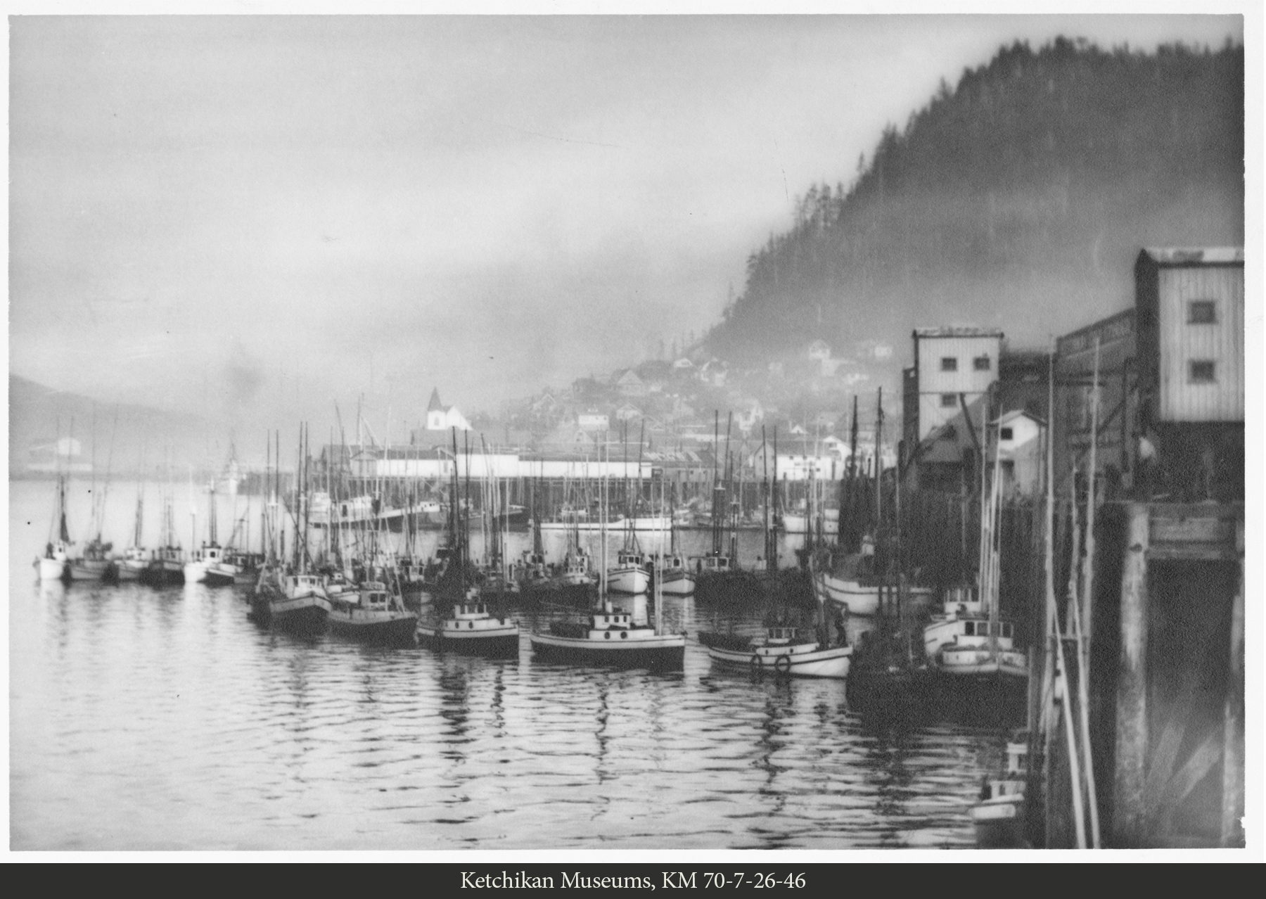 Trollers strung out at the Ketchikan Cold Storage Company dock